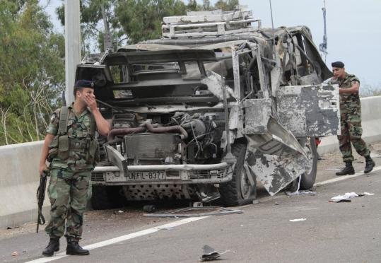 Lebanese soldiers stood guard yesterday next to a destroyed Italian UN armored vehicle.