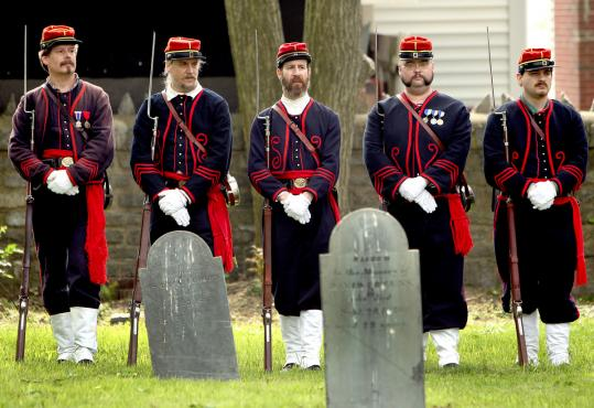 Reenactors of the 8th Massachusetts Regiment took part in yesterday's event at Rumney Marsh Burial Ground. Middle and high school students provided an overview of Civil War history.