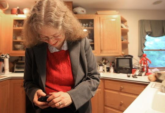 "Amy S. Schneider (checking an insulin pump reading at her Newton home) said her diabetes has ""made me much more aware, healthier, knowing about things that are important to know.''"