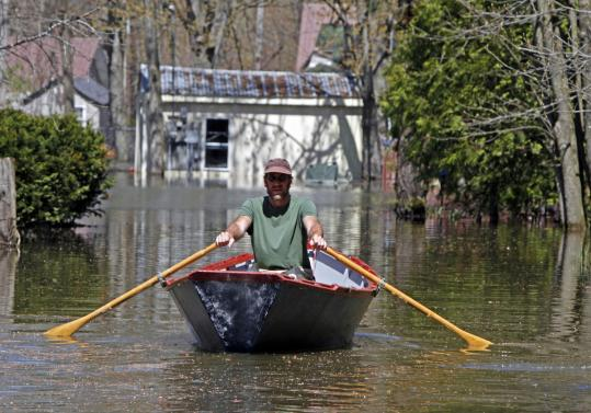 Lake Champlain's rising waters have forced many Vermonters, such as Jim Paulsen (above) of Burlington, to cope with flooding.
