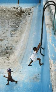 ''Havana,'' a 2000 photo by Alex Webb, shows two children in an empty swimming pool.