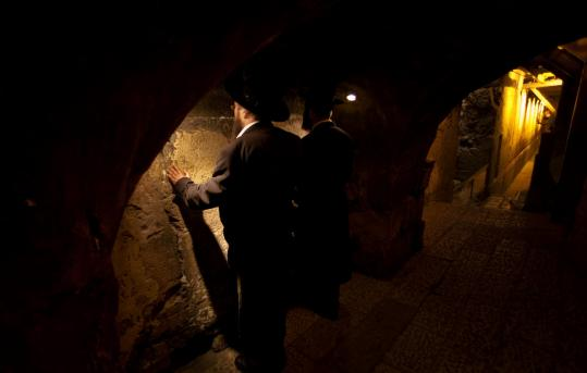 Orthodox Jewish men prayed in the Western Wall tunnel in Jerusalem&#8217;s Old City. When the newest underground link opens, there will be more than a mile of pathways beneath the city.
