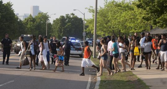 Police dispersed crowds at Carson Beach in Boston after fights broke out. Officials say hundreds of unruly youths boarded trains at JFK/UMass Station and started fights elsewhere.
