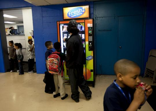 The Boys & Girls Club of Dorchester has a snack machine from Fresh Healthy Vending, which offers baked pita chips, applesauce, and all-natural sodas. But are they really healthy?