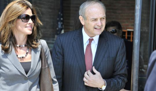 Prosecutors say Salvatore F. DiMasi, the former House speaker, above with his wife, Deborah, had amassed a credit card debt of $50,000, which he did not have to report on disclosure forms.