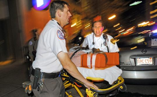 EMTs Richard Covino (right) and Jay Weaver helped an injured man in the Back Bay. Covino also works full time for Massport.