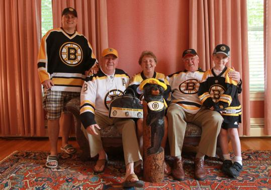 The Murphys of Dorchester have filled seats at Boston Bruins games for four generations over 72 years now. Here, Brendan (left), Paul, Pat Meagher, Jim, and Thomas show their true colors.