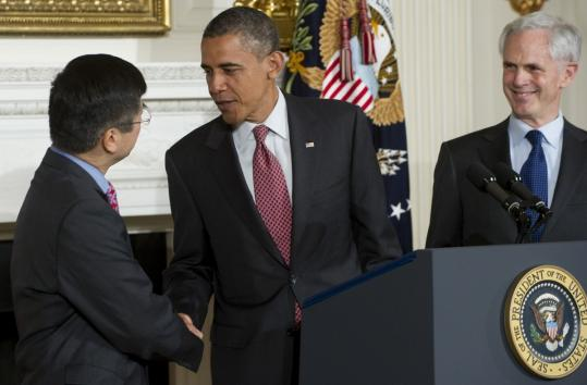 President Obama shook hands yesterday with outgoing Secretary of Commerce Gary Locke, alongside John Bryson.
