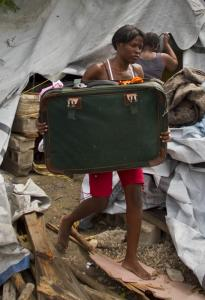 A woman evicted from a camp in Port-au-Prince last week moved her things. Many say they have nowhere to go.