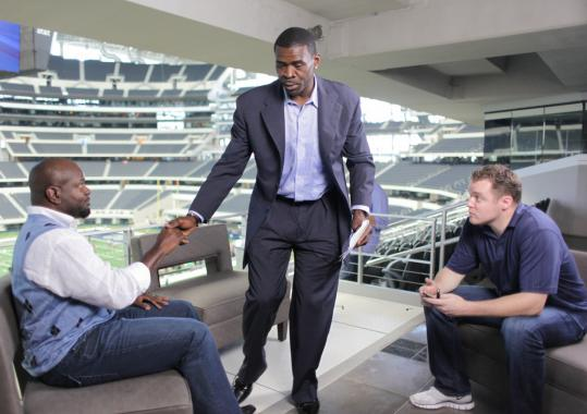 Jason Hehir (right) with Emmitt Smith (left) and Michael Irvin on an NFL Network set.