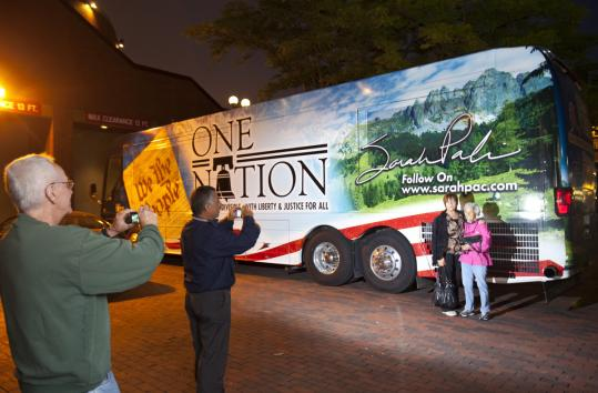 Sarah Palin's tour bus quietly stopped at a Boston hotel, where onlookers and tourists took pictures of the bus.