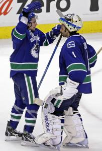 Roberto Luongo (right) earns a salute f