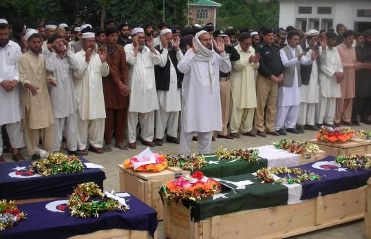 "Pakistanis took part in funeral prayers for security personnel who lost their lives during fighting against militants, yesterday in Upper Dir. Pakistan's government said that about 300 to 400 fighters ""attacked villages and burned schools.''"