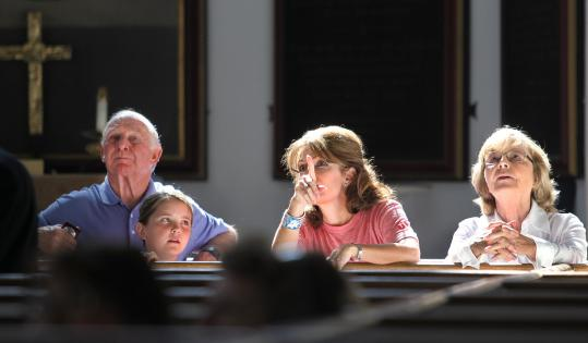 Sarah Palin listened to a lesson on the history of the Old North Church by Vicar Stephen Ayres. Palin was joined by her father, Charles Heath, daughter Piper, and mother Sally Heath.