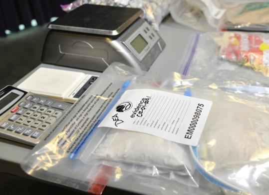 Officials displayed evidence seized in raids yesterday, including two kilos of heroin.