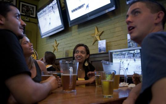 Paul Granz, Lauren Bosco, Anna Araujo, and TJ White watched Game 1 of the Stanley Cup finals at Sports Grille Boston on Wednesday night.