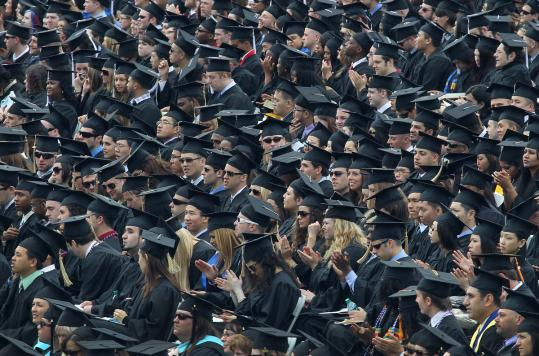 Graduates listened at the UMass Boston commencement.
