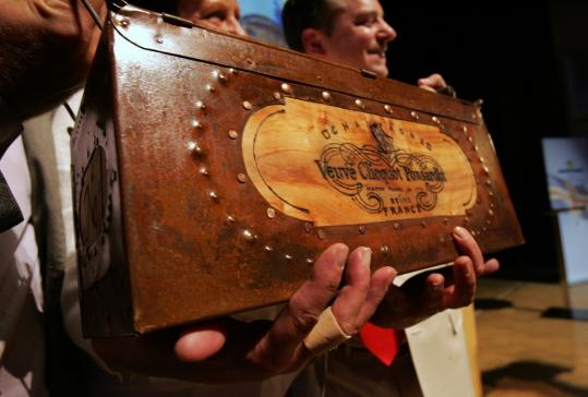 Auctioneer John Kapon held a box of Veuve Clicquot, a champagne made in the 1800s and found in a shipwreck.