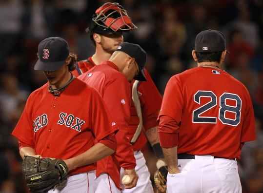 Clay Buchholz, who allowed four runs in the first inning, departed after giving up eight hits and six runs in 4 2/3 innings.