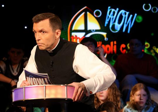 "The Rev. Robert Reed, president of the Watertown-based CatholicTV Network, serves as host of ""WOW,'' a religious-themed game show."
