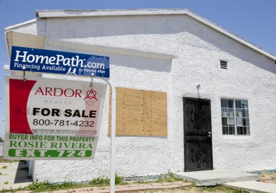 A sign in front of a foreclosed property in Los Angeles offered financing from Fannie Mae. Continued high unemployment is complicating the government's efforts to slow foreclosures.