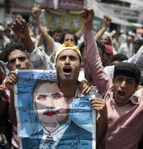 Antigovernment protesters held a defaced portrait of President Ali Abdullah Saleh during a demonstration for his ouster in Sana, Yemen. Saleh was wounded in a rocket attack.