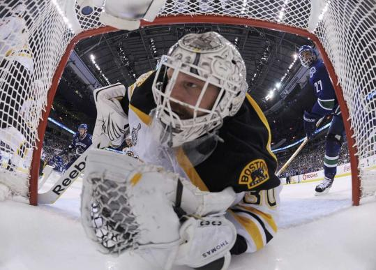 Tim Thomas was in the Bruins' net again last night, literally, trying to get a glimpse of the puck during action in the second period of the Canucks' 3-2 win in overtime.