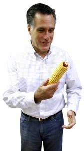 Mitt Romney holds an ear of corn during a visit to an agriculture software firm in Iowa. Associated Press