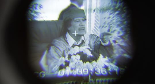 Libyan Leader Moammar Gadhafi is seen through a television camera viewfinder as he speaks in Tripoli, Libya, in March.