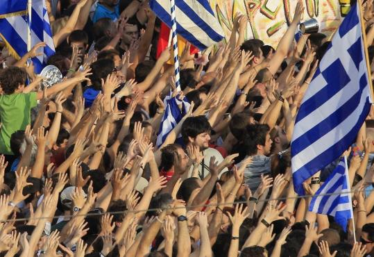 Protesters in Athens&#8217; Syntagma square demanded that the country stop payments to creditors.
