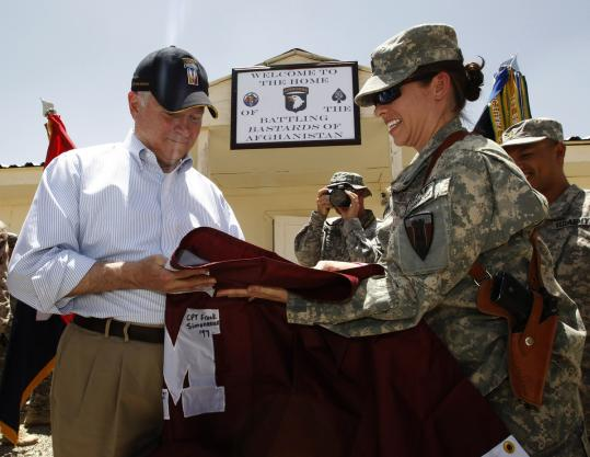 Secretary of Defense Robert Gates signed a banner at Forward Operating Base Sharana in Paktika Province yesterday.