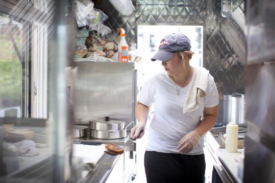 Erin Hockey makes a Blue Man Goo sandwich at Grilled Cheese Nation downtown.