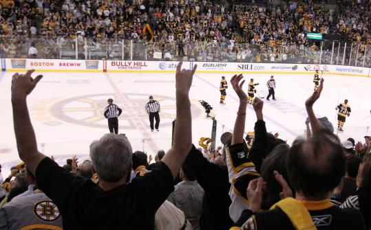 Fans cheer after the Bruins win Monday.