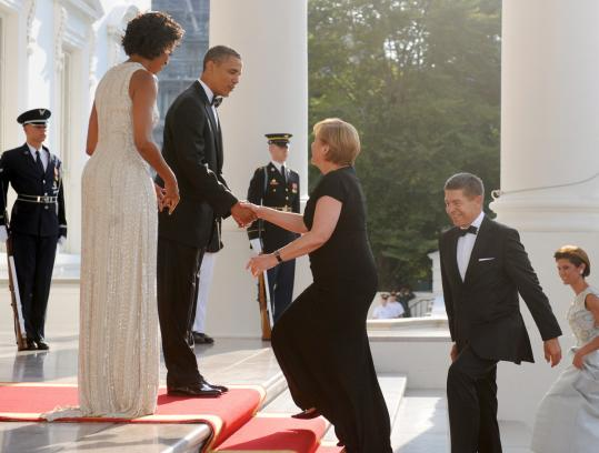 President Obama, with his wife, Michelle, greeted Chancellor Angela Merkel of Germany and her husband, Joachim Sauer (right), at the White House last night for a state dinner at which Merkel was awarded the Presidential Medal of Freedom.