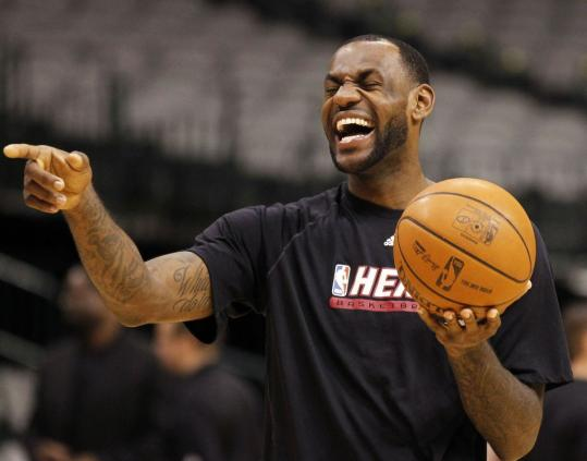 LeBron James is able to laugh during practice yesterday, but he wasn't so happy after he scored only 8 points in Game 4 of the Finals Tuesday, a contest the Heat lost.