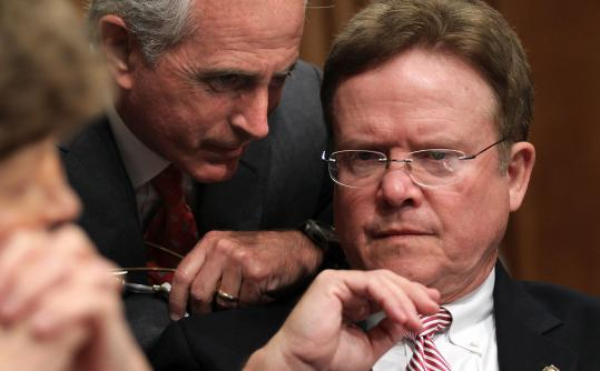 Senator Bob Corker of Tennessee (center) with Virginia Senator Jim Webb yesterday during a Capitol Hill hearing