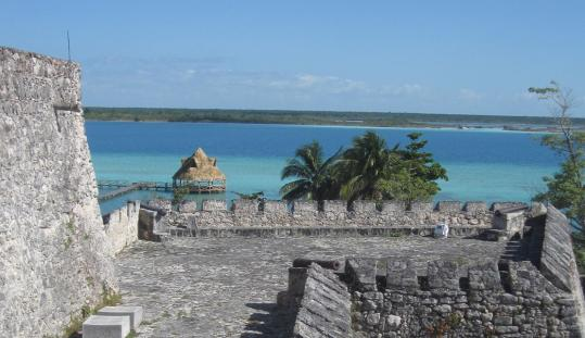 Looking out at the lagoon in Bacalar, Mexico, just north of the Belize border, from the San Felipe Fort, built by the Spaniards in the 18th century, and from a catamaran in the Pirate's Channel.
