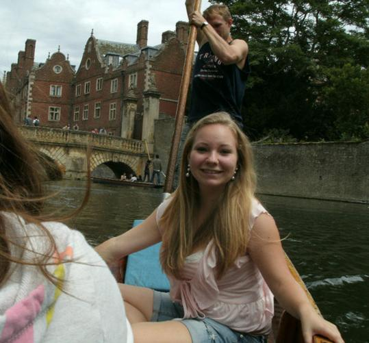 Alexandra Churchill punting with friends on the River Cam in Cambridge, England.
