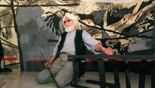 "M.F. Husain with a 40-foot canvas, ""Violence,'' in Mumbai in 1999. He was an instantly recognizable figure in India's art world."