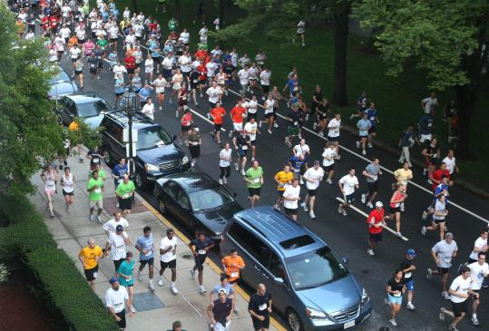 Runners surged along Commonwealth Ave. last year for the J.P. Morgan Corporate Challenge race.