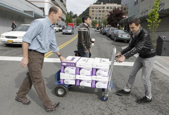 Journalists carried boxes containing the thousands of e-mails from Sarah Palin's time as governor across a street in Alaska. The e-mails came in a set of five 55-pound boxes.
