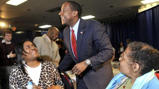 Mayor Setti Warren is joined by his sister, Makeda Warren-Keegan (left), and mother, Elpidia Lopez, at a campaign event in May.