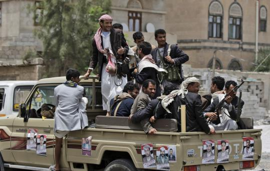 Tribesmen loyal to Sheik Sadeq al-Ahmar, the head of the powerful Hashid tribe, gathered on the back of a vehicle while patrolling the area around Ahmar's house in Sana, Yemen.