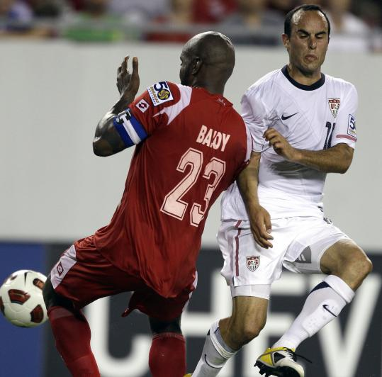 Panama's Felipe Baloy takes the ball away from Landon Donovan during the second half of US team's 2-1 loss.