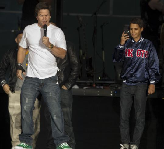 Mark Wahlberg (with one of his nephews nearby) introduced NKOTBSB to a sold-out crowd at Fenway.
