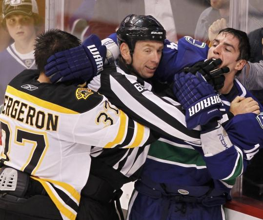 Alex Burrows (right) bit the tip of Patrice Bergeron's finger during a melee in Game 1 of the Stanley Cup Final in Vancouver, and Bruins fans aren't likely to forget it any time soon.