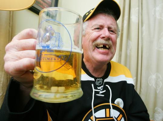 Nova Scotia's Bill Estabrooks removes his false teeth before playoff games for good luck.