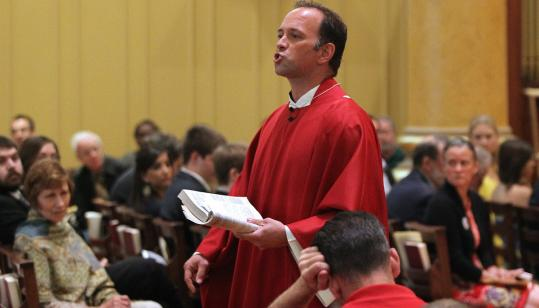 The Rev. John Unni delivered his homily yesterday while pacing the center aisle.