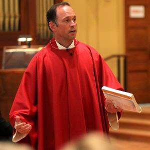 During Mass in St. Cecilia Parish on Sunday, the Reverend John Unni makes a statement about the decision of the Boston Archdiocese.