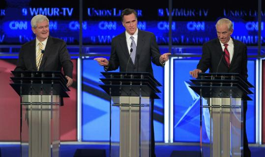 During the N.H. debate, Mitt Romney was flanked by Newt Gingrich and Representative Ron Paul of Texas (right).